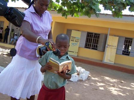 A students reads from Nelson Mandelas biography at the Ogoja library opening